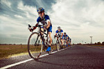 Competitive bicyclists racing on remote rode